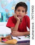 Little Boy On His School Desk
