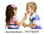 girl shares, gives or feeds boy with her ice cream in studio isolated - stock photo