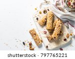 Stock photo cereal granola bar with nuts fruit and berries on a white stone table healthy sweet dessert snack 797765221