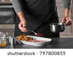 chef adding cranberry sauce to...   Shutterstock . vector #797800855