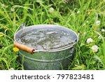 rain. full  bucket with rain...   Shutterstock . vector #797823481