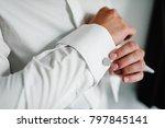 hand's groom wears a metallic... | Shutterstock . vector #797845141