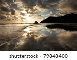 A Tropical Beach At Sunset In...