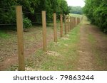 Long Fence Of Wooden Posts And...