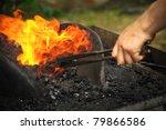 Blacksmith Heating Up Iron  ...