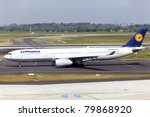 DUSSELDORF, GERMANY - MAY 21: Airbus A330 lands on May, 21 2011 in Dusseldorf airport, Dusseldorf, Germany. Lufthansa services around 410 destinations with over 710 aircraft. It has the second airline fleet in the world - stock photo