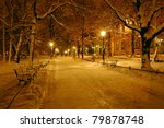 Alley in a park covered with snow in old town of Krakow - stock photo