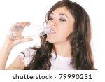 young brunette woman drinking... | Shutterstock . vector #79990231