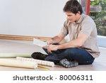 young man sitting on floor... | Shutterstock . vector #80006311