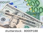 Two influential currencies over world economy - US Dollar versus Euro - stock photo