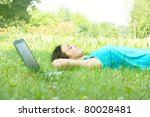Student relaxing at the nature. - stock photo