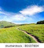 pathway on green ridge in mountains - stock photo
