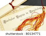 A diploma and grad hat represent a high achieving student in the field of psychology. - stock photo