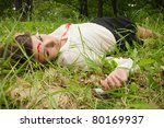 Crime scene in a wood with dead secretary - stock photo