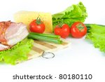 Arrangement with meat smoked bacon, tomatoes and cheese on Cutting board - stock photo