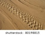 Patterns On A Sandy Beach With...