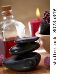 balanced black stones and essential oil - stock photo