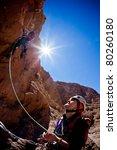 A Female Climber Belays The...