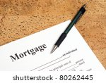 A closeup shot of mortgage forms for the people buying a house. - stock photo