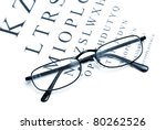 An eye chart with a pair of glasses to emphasize vision correction. - stock photo