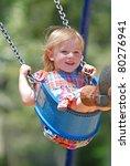 Three Year Old Girl Swinging...