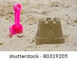 Sandcastle With A Shovel