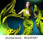 sensual beautiful woman in green fabric - stock photo