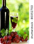 grapes with a bottle of wine and glass - stock photo