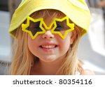 Little Blond Girl Wearing Star...