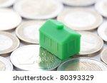 Miniature green house on euro coins - stock photo