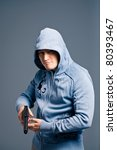 Young man with pistol - stock photo