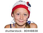A young girl with crocheted hat in red, white, and blue. - stock photo