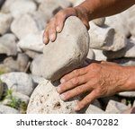 Building Balanced Stack Of Rocks - stock photo