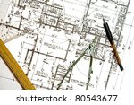 Various drawing instruments laying on a blueprint of a portion of a private residence. - stock photo
