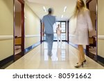 Staff walking through the hallway in hospital - stock photo