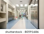 Blurred motion of doctor walking in a hospital corridor - stock photo