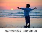 Little Boy Silhouette On Beach...