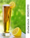 cold beer and lemon. - stock photo