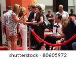 LOS ANGELES - JUL 7:  Jennifer Aniston, Justin Theroux (White shirt, black tie and hair) at the Jennifer Aniston Handprint & Footprint Ceremony at Grauman's Chinese on July 7, 2011 in Los Angeles, CA - stock photo