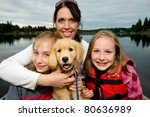 pretty family at a lake - stock photo