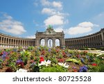 The Triumphal Arch in Cinquantennaire Park in Brussels in summer with flowers on front of it - stock photo