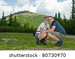 young couple near snezka mountain - stock photo