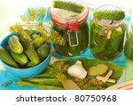 preparing preserves of pickled cucumbers in jars  with spices and herbs - stock photo