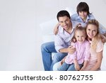 happy family on the couch | Shutterstock . vector #80762755