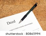 A closeup shot of deed forms ready for signing. - stock photo