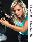 young woman looking through an 8 inch reflector telescope - stock photo