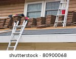 A new roof is added in replace to the old on a residential home. - stock photo