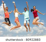 Portrait Of Four Jumping Happy...