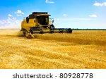 Постер, плакат: combine harvester on a