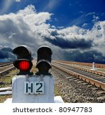 red semaphore on the rail road - stock photo